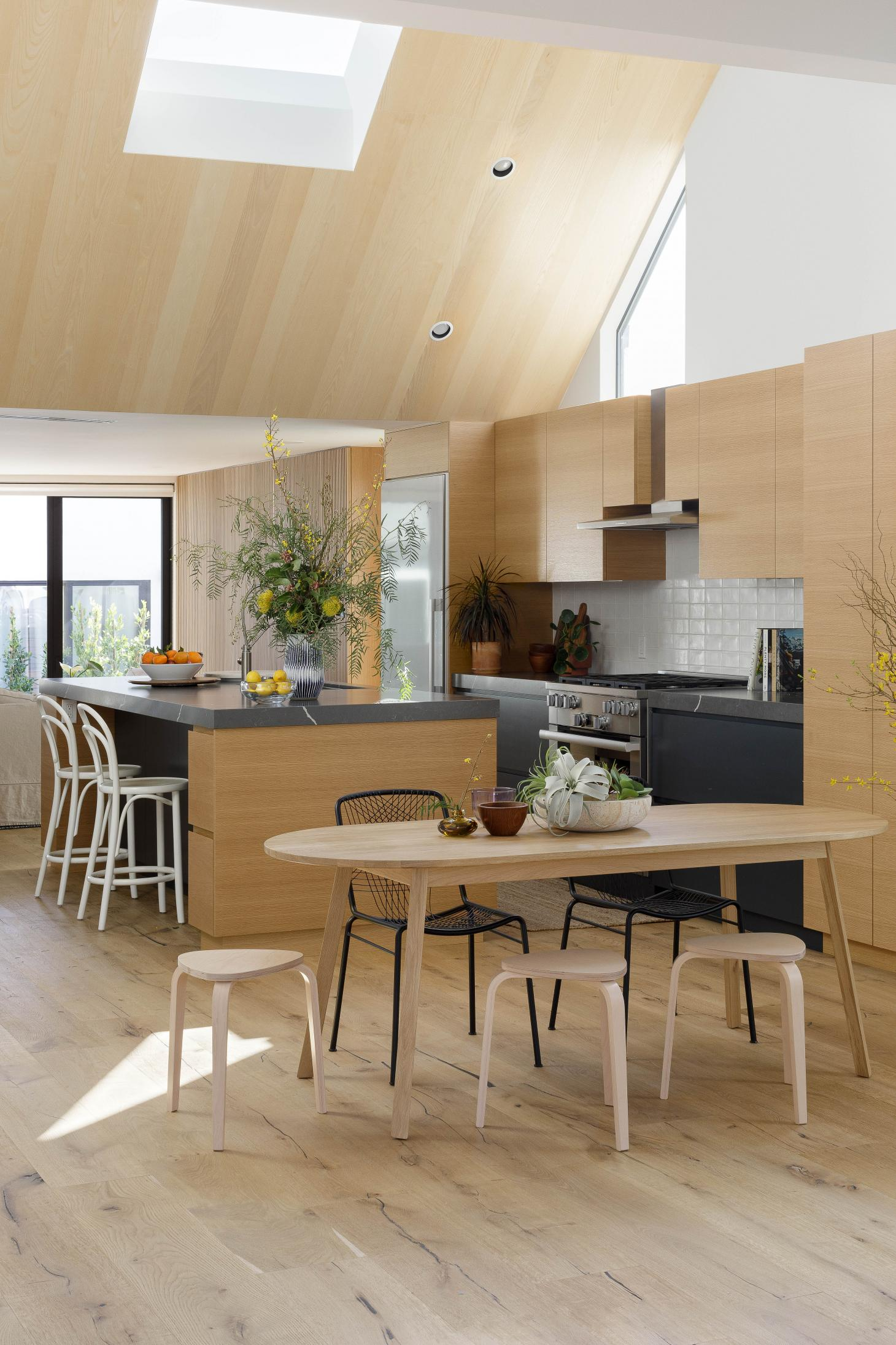 timber clad kitchen and dining area at the Curson Residence by Nwankpa Design