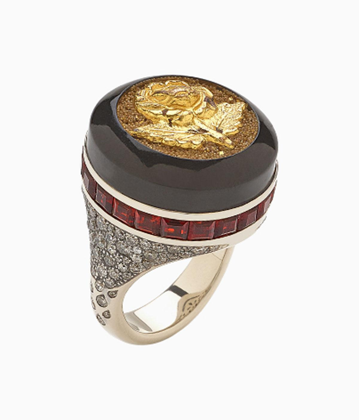 Black and diamond ring with a button set into it