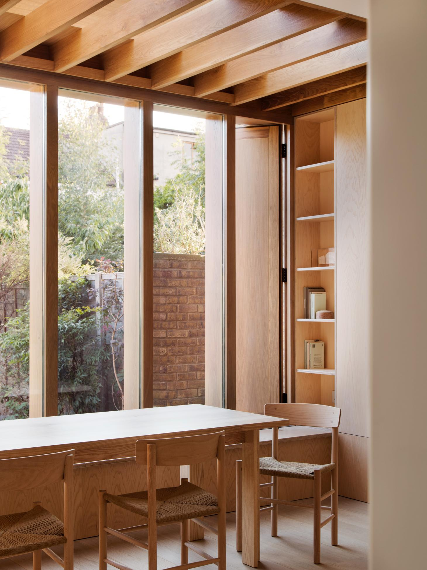 dining area within all timber interior in London's Dewsbury road