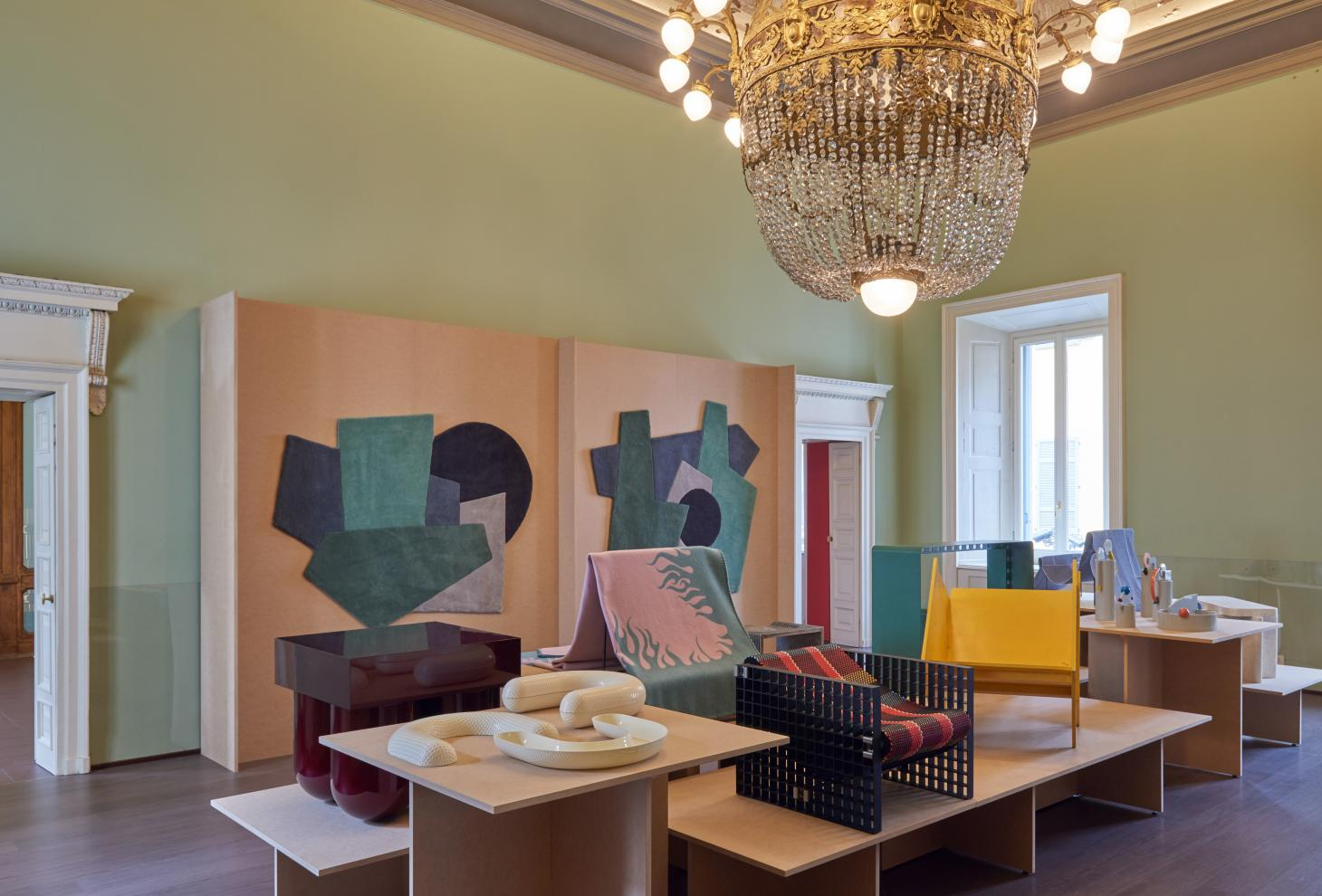 Furniture and objects on display in historical property during Como Design Festival