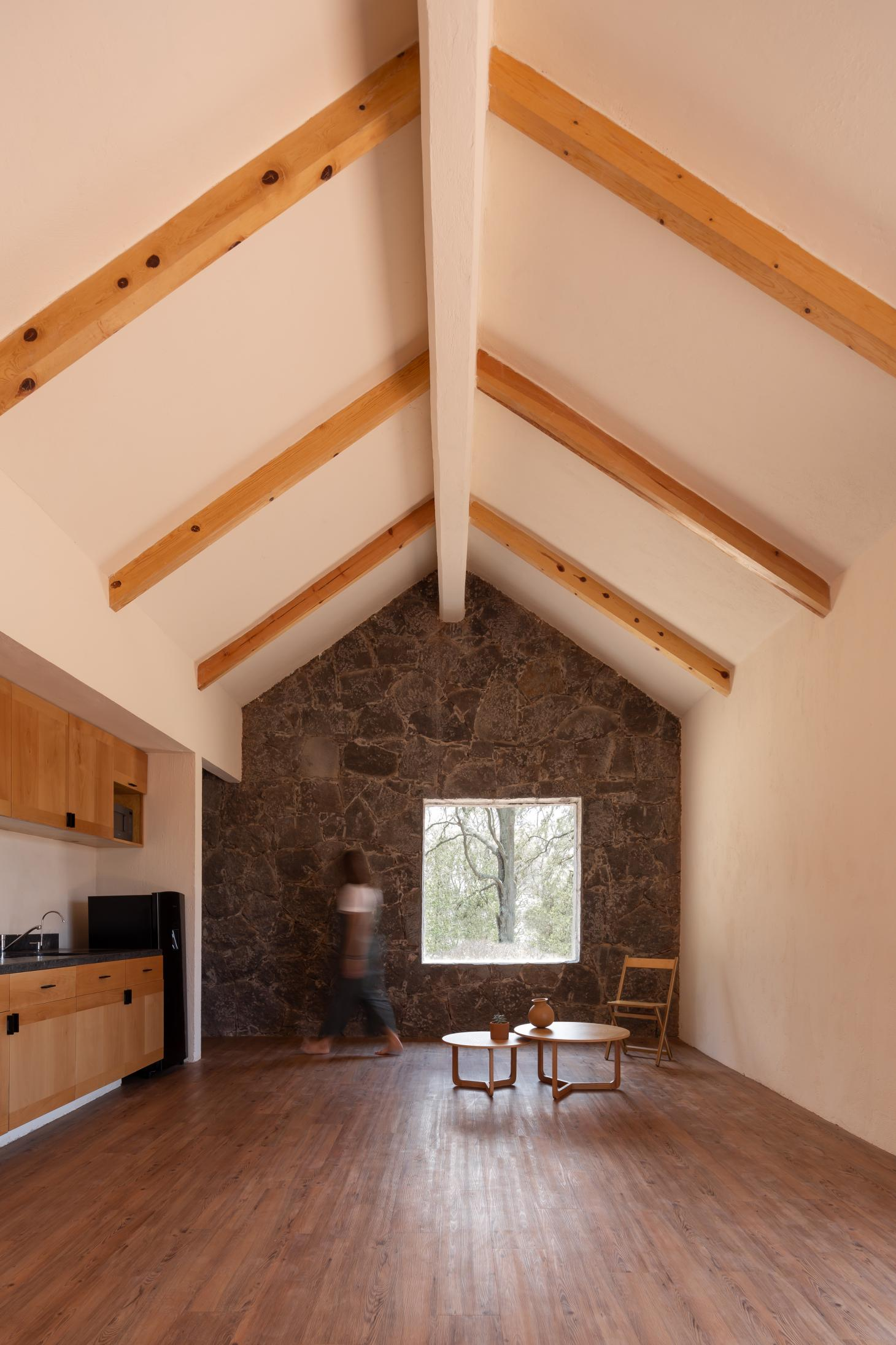 living room under pitched roof in rural Mexico house by architects Palma MX