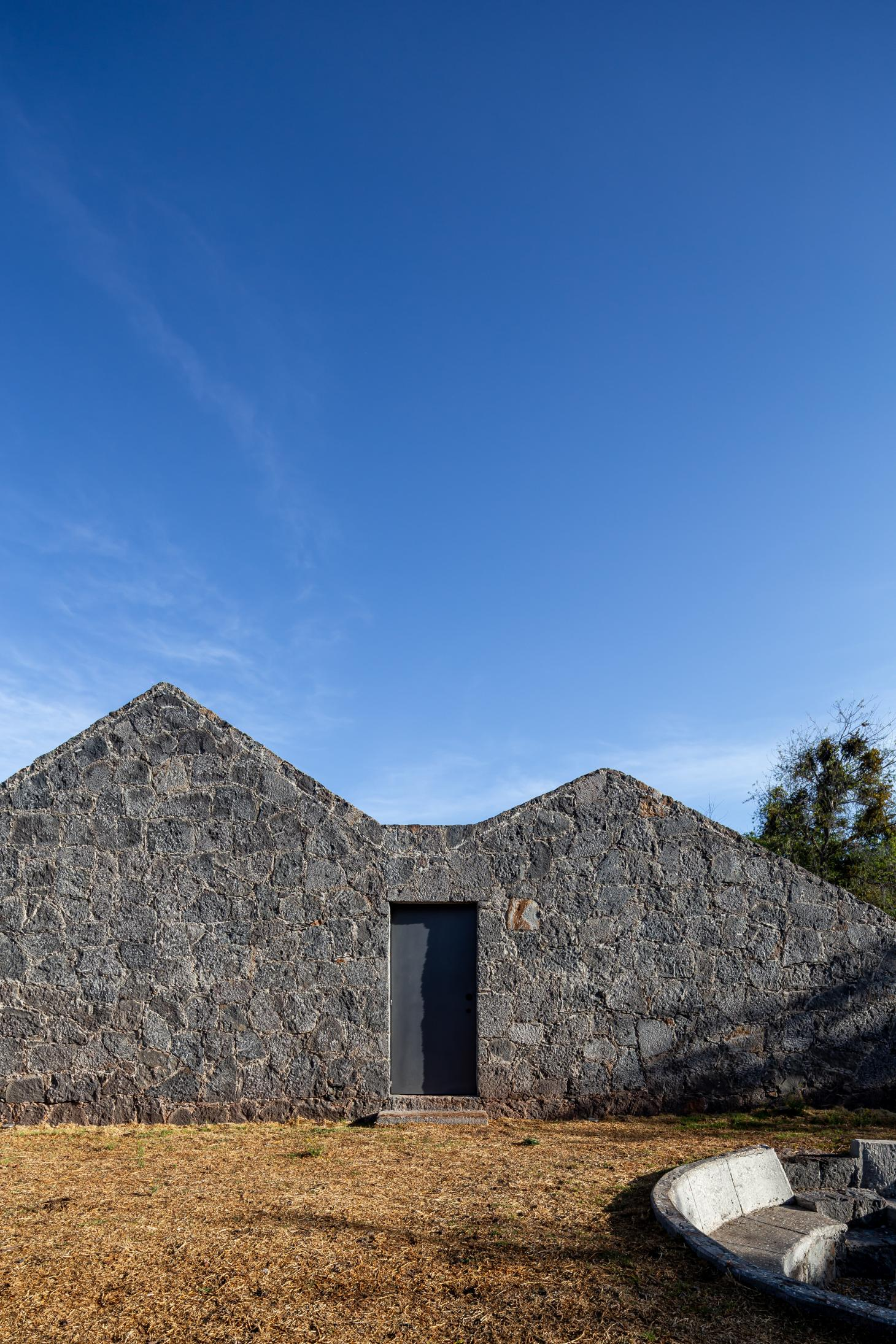 angled stone walls and blue skies in Mexico