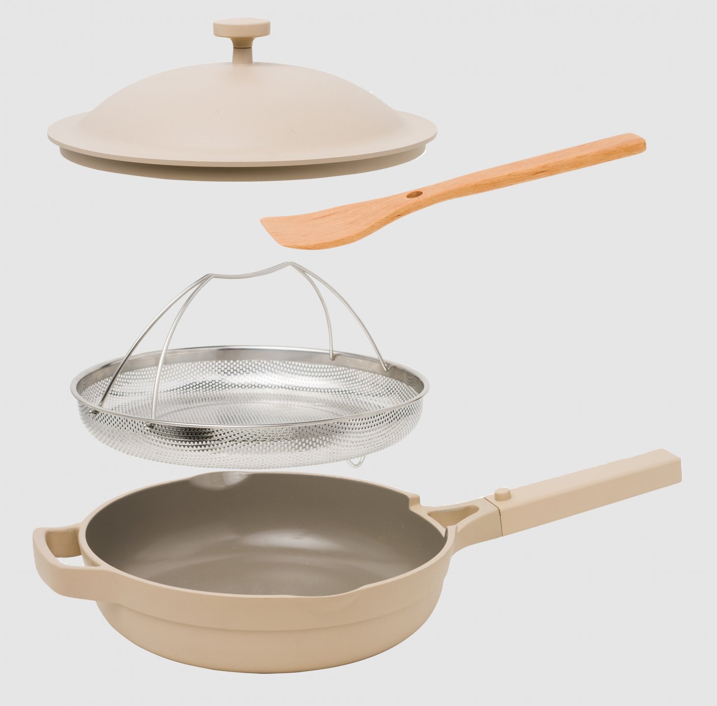 The Always Pan made by Our Place in light gray with steamer and spoon
