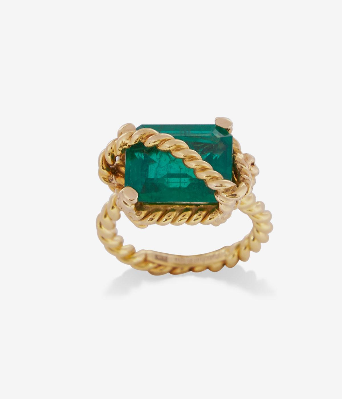 Emerald ring with gold rope crossing over it