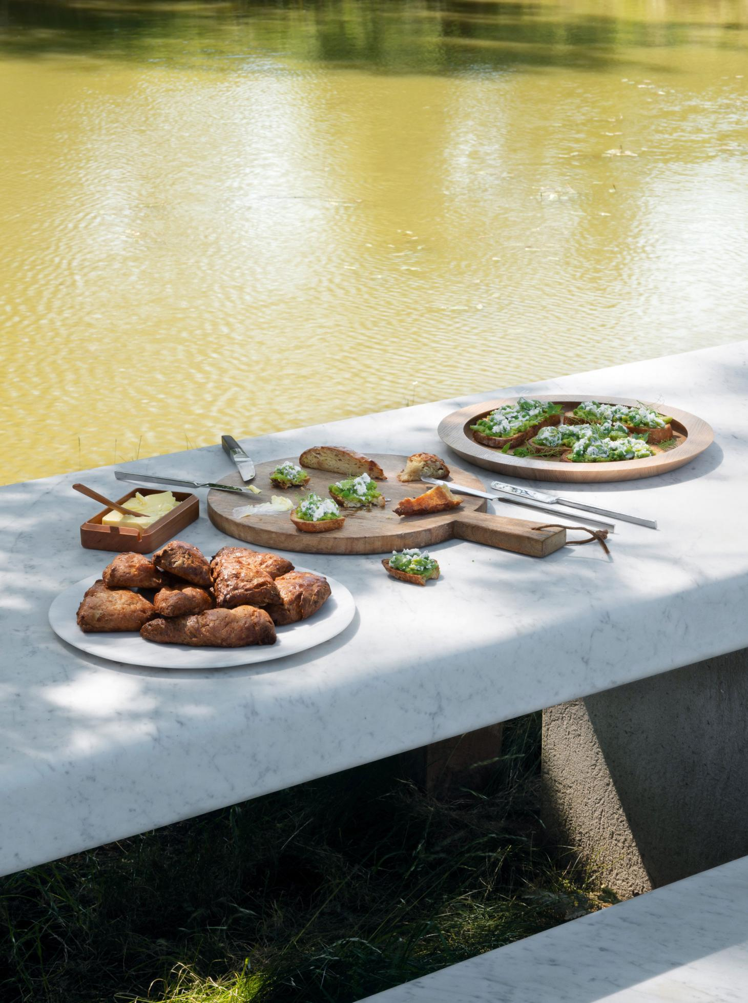 John Pawson Home Farm Cooking Spring recipes laid on white marble table in the garden