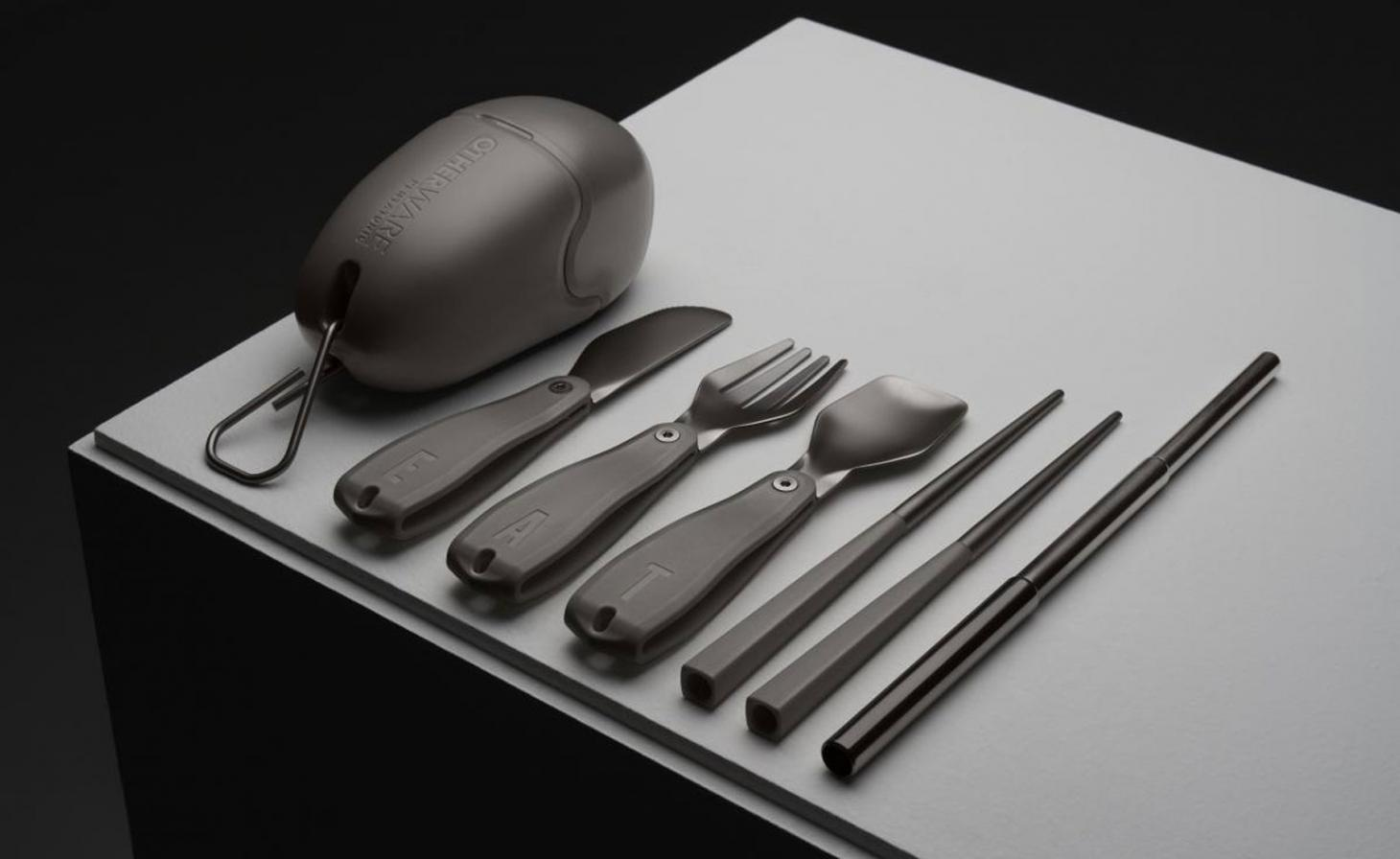 Dark knives and forks next to a small case