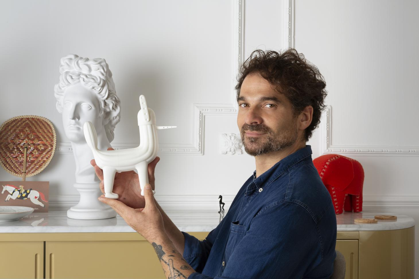 Jaime Hayon at home in Valencia with a miniature figurine that inspired his MOKA Playground design
