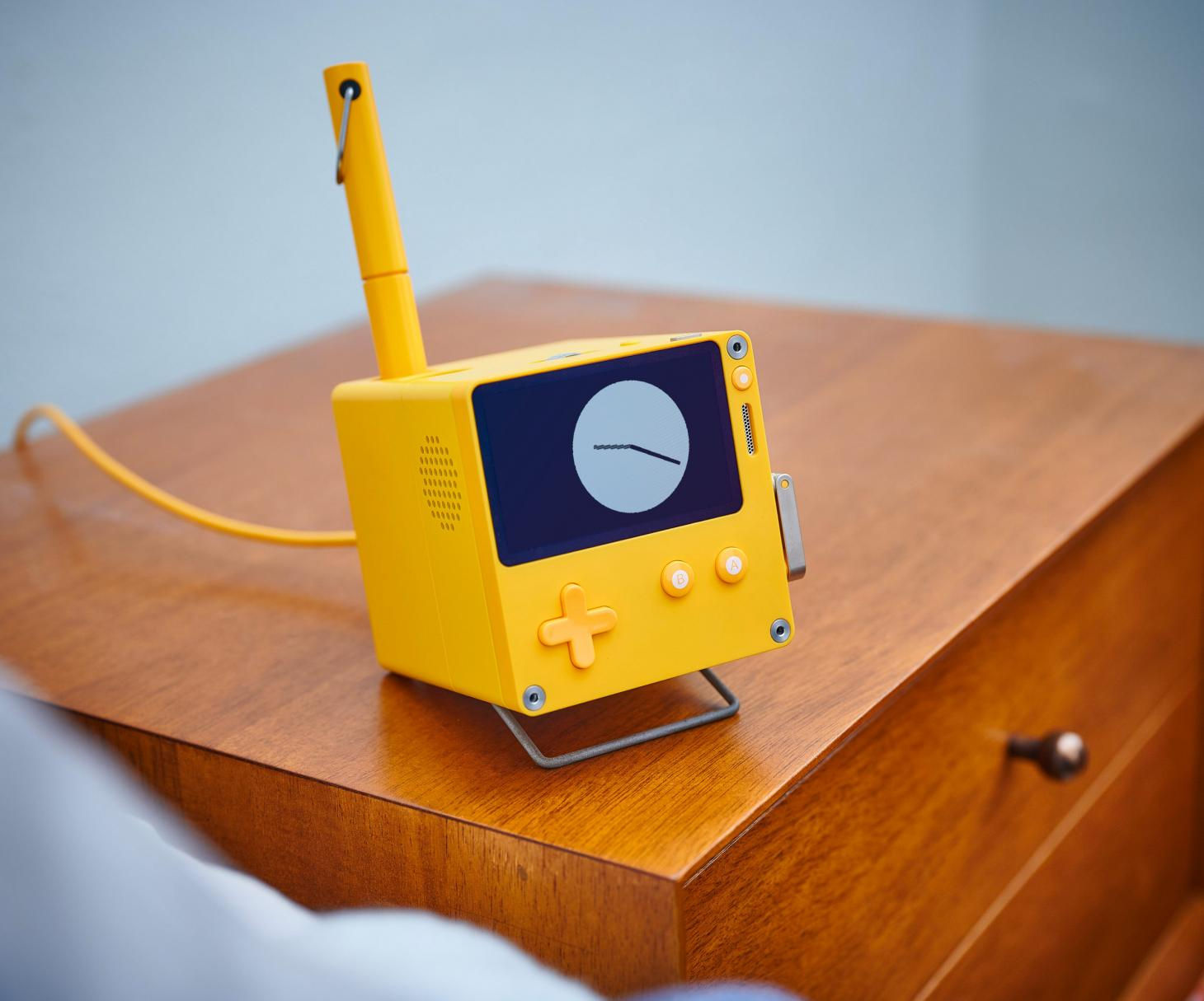 Playdate pocket console by Panic with its optional Stereo Dock