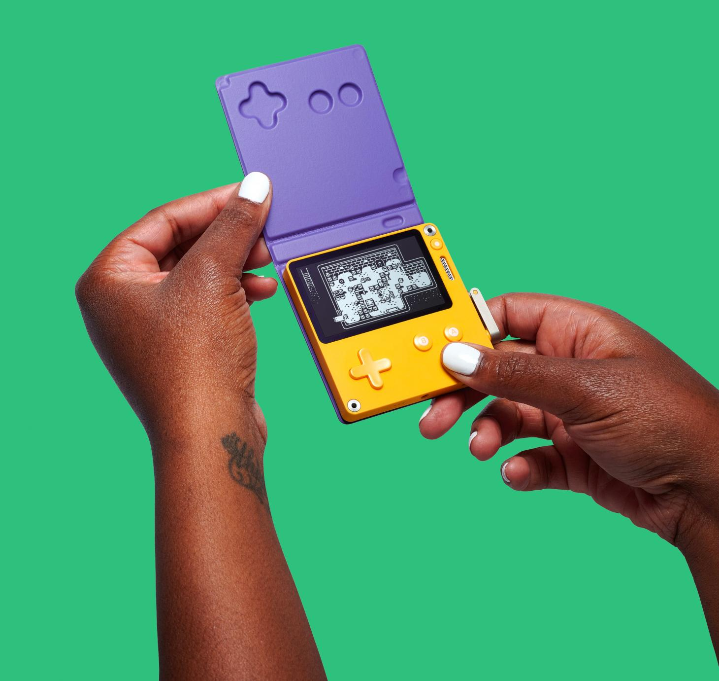 Playdate pocket console by Panic with its optional cover