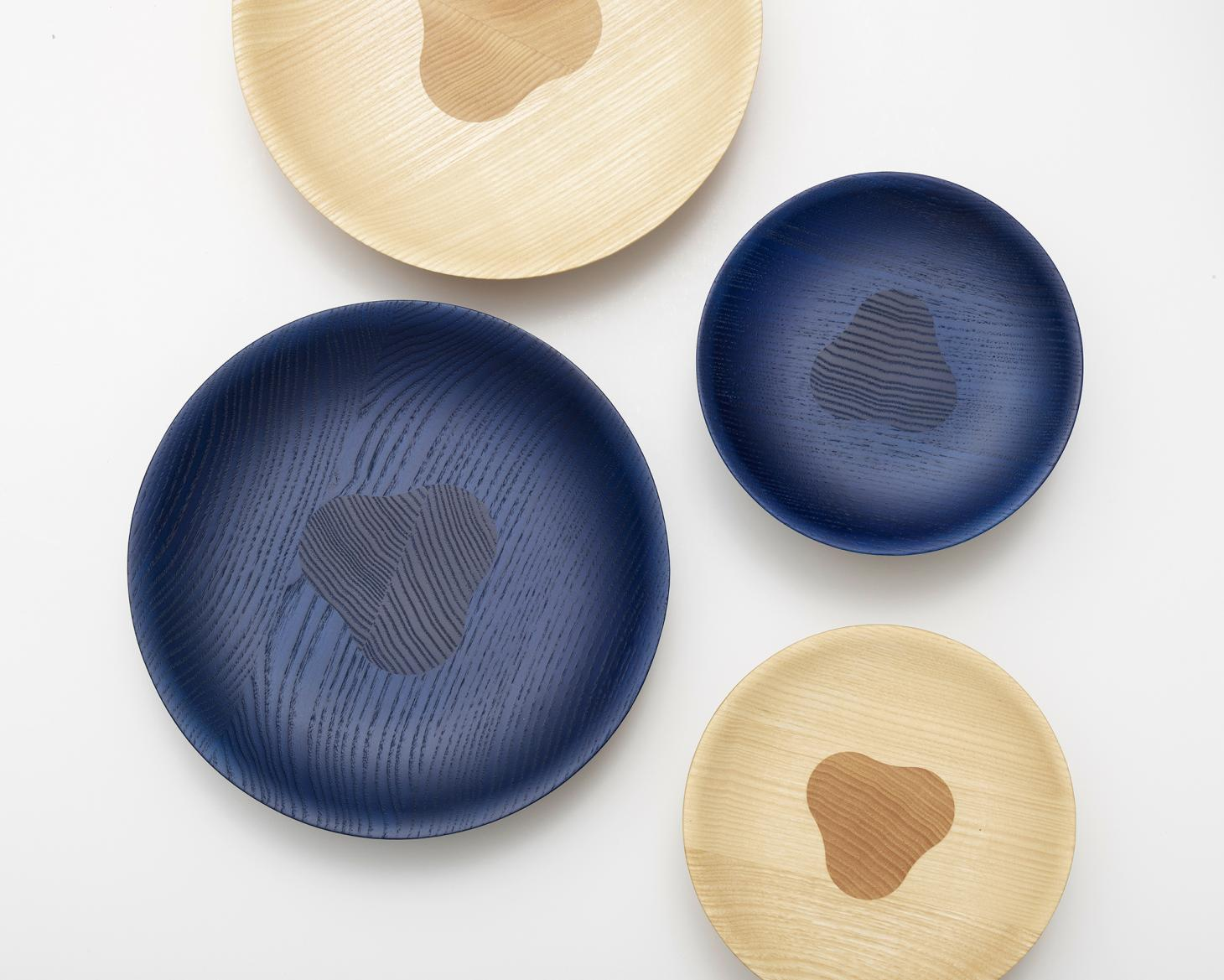 Wooden bowls shot from above in natural and blue stained wood