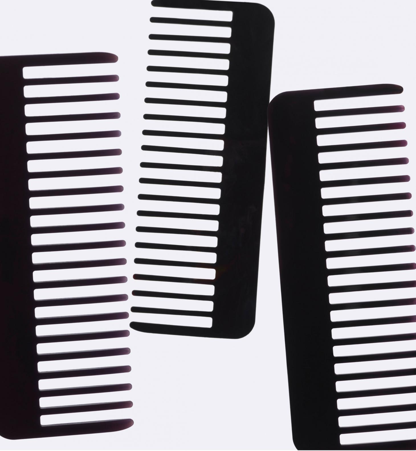 Three black Re=Comb combs
