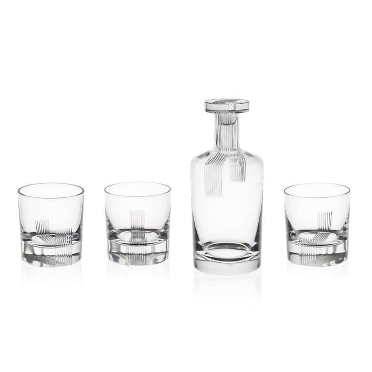 Three tumblers and one bottle in thick crystal glass with striped engraving