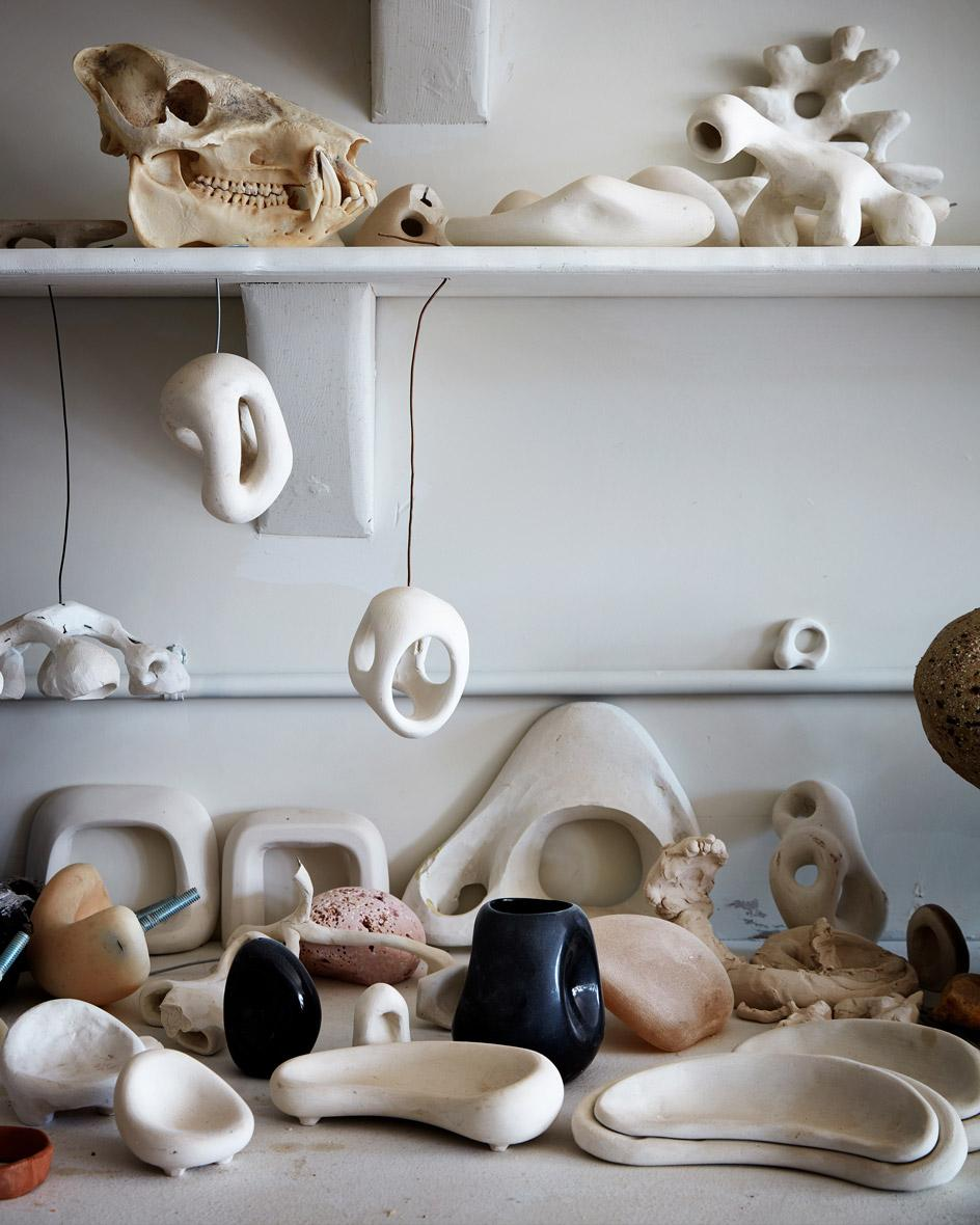Sculptures and reference objects on shelves in Rogan Gregory's new studio in LA