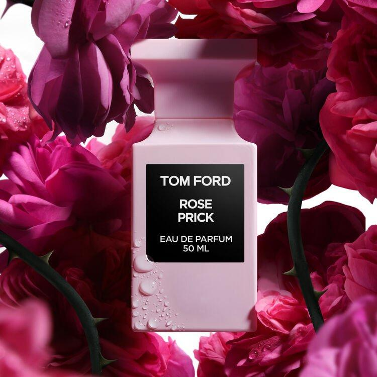 tom ford rose prick perfume in pink bottle with black label surrounded by bright pink roses