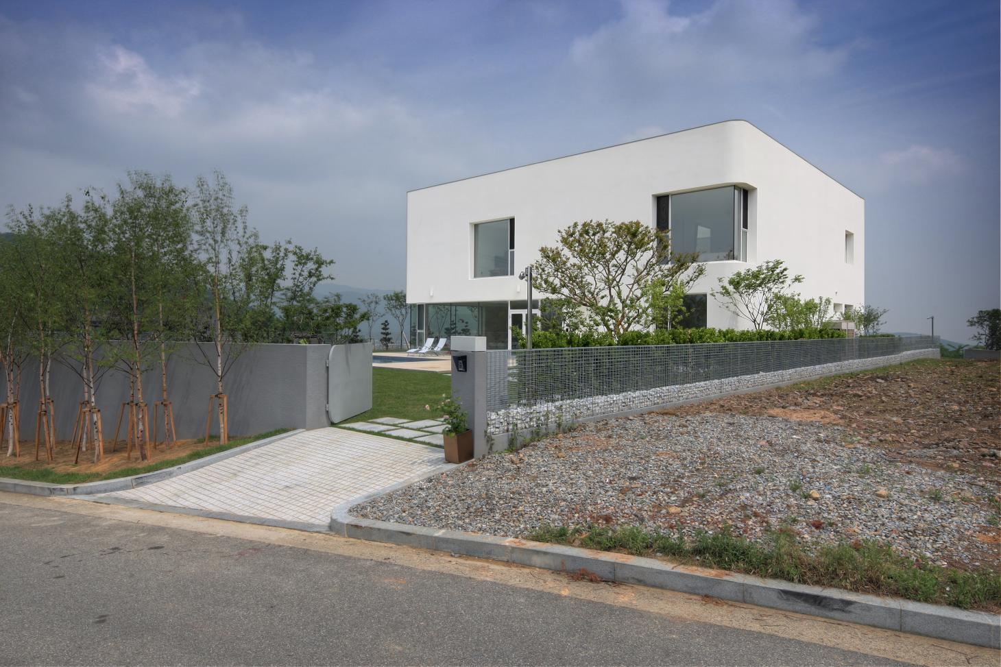 defined by a white boxy composition with curved corners this is Korea's Rounded House