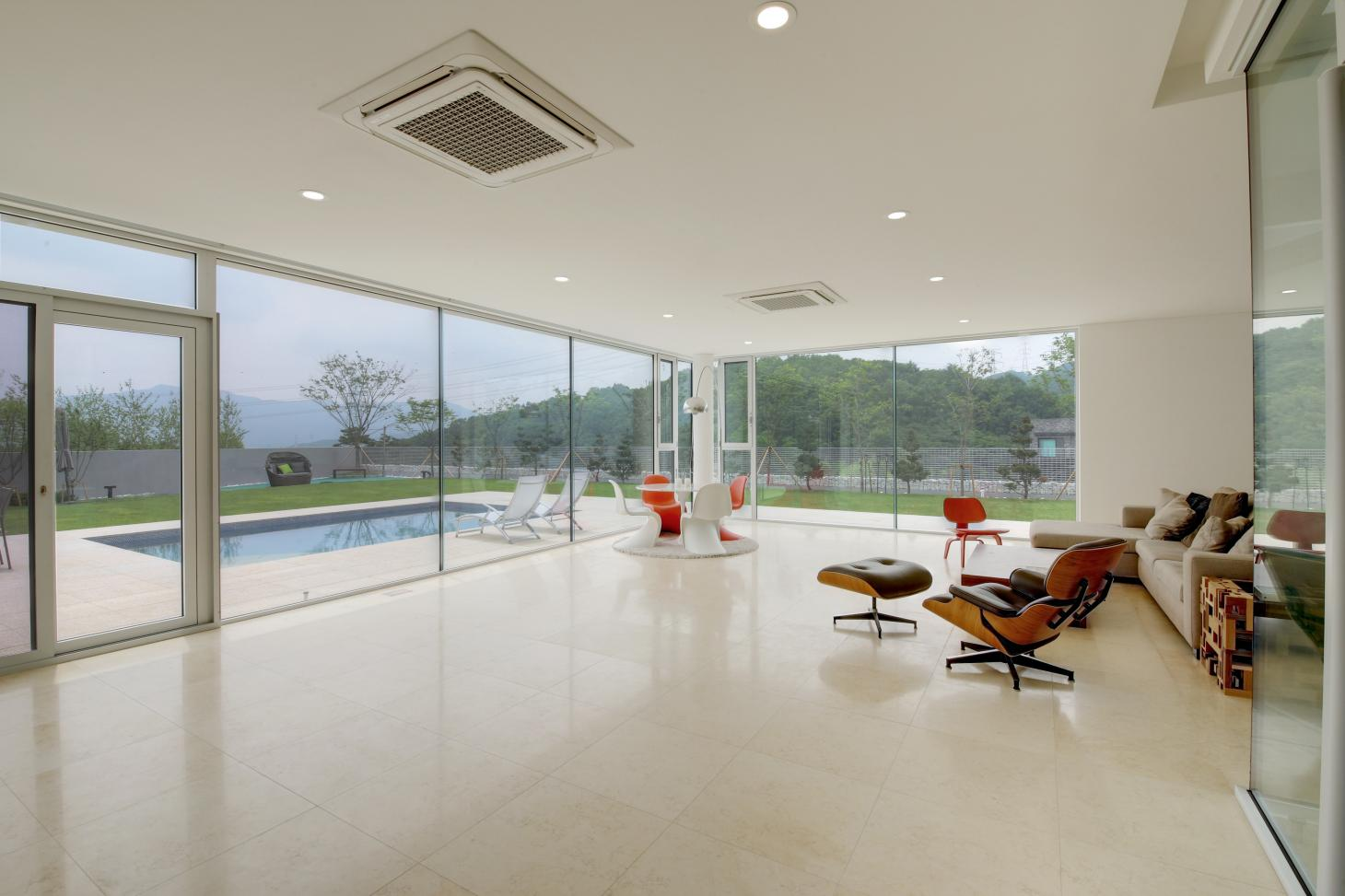 South Korean rounded house's vast minimalist white living space