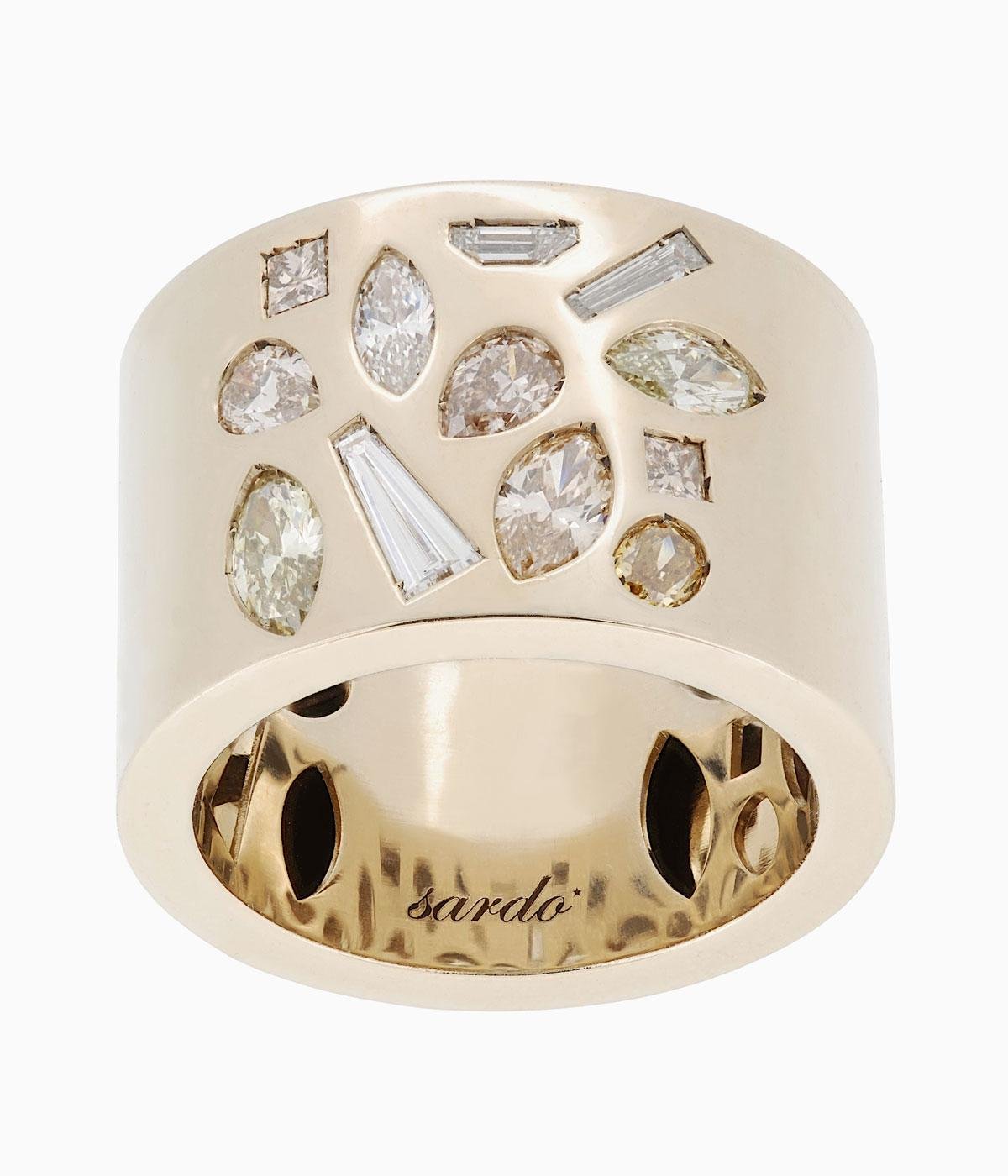 Gold ring with diamond petals in it