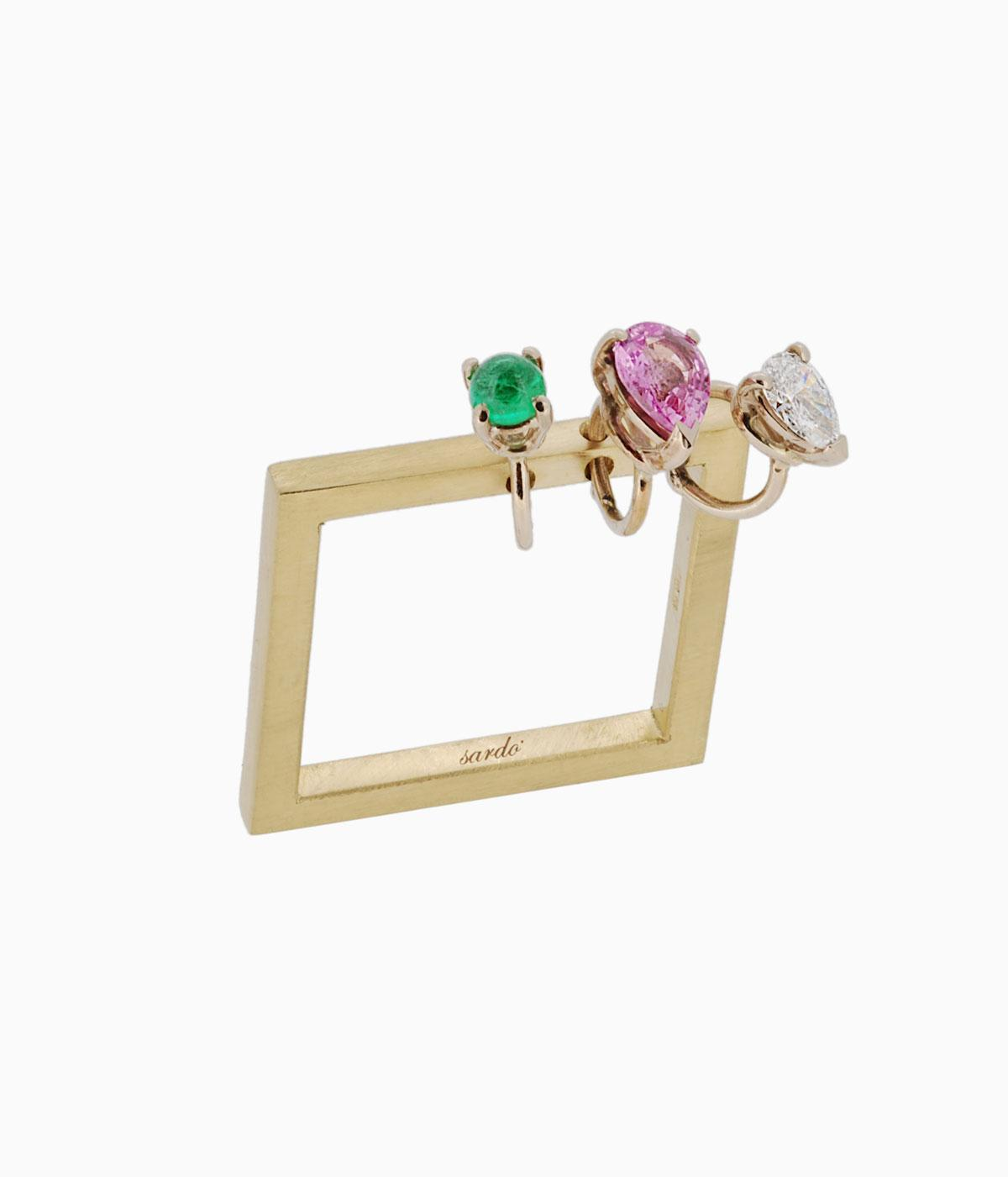 Gold square ring with coloured stones on it