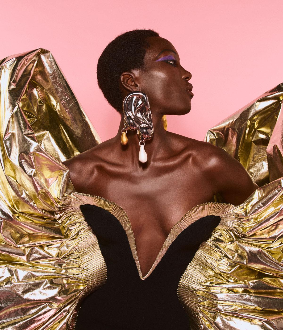 Woman wearing a dress with gold wings