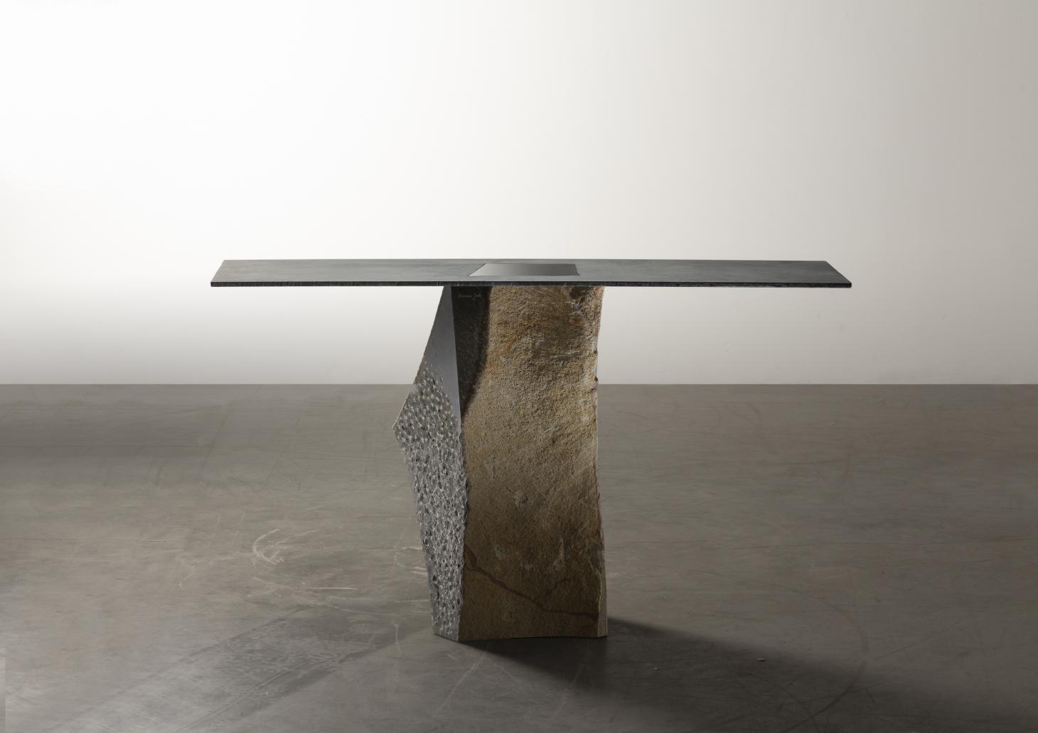 Table with stone base and square steel top