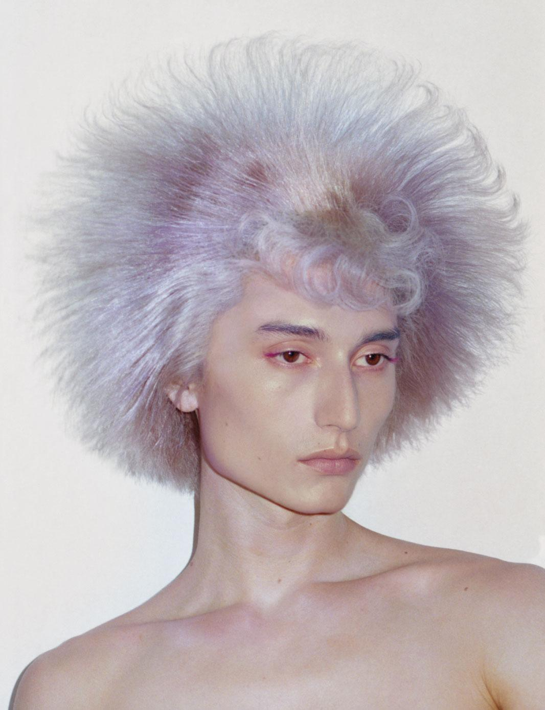 a man with purple wig