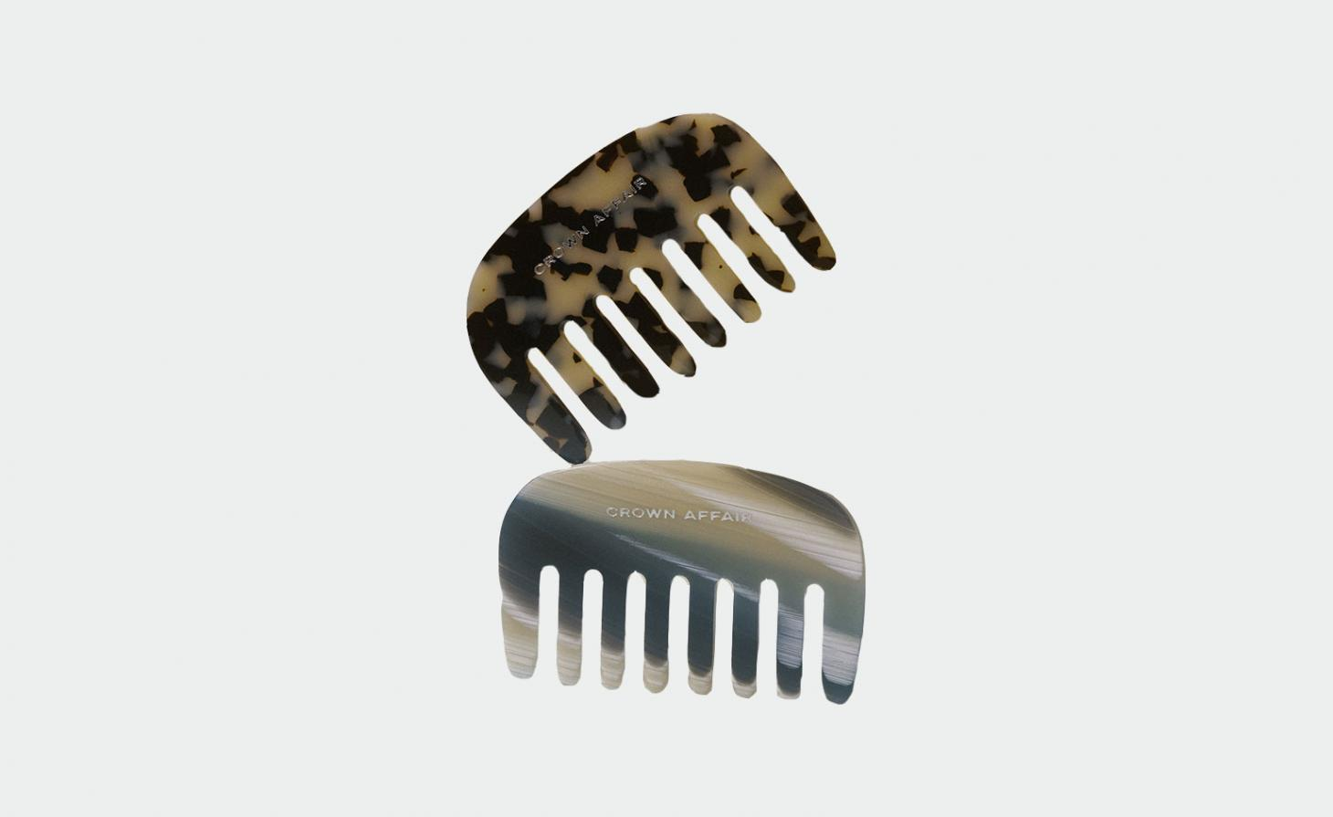 two combs against a grey background