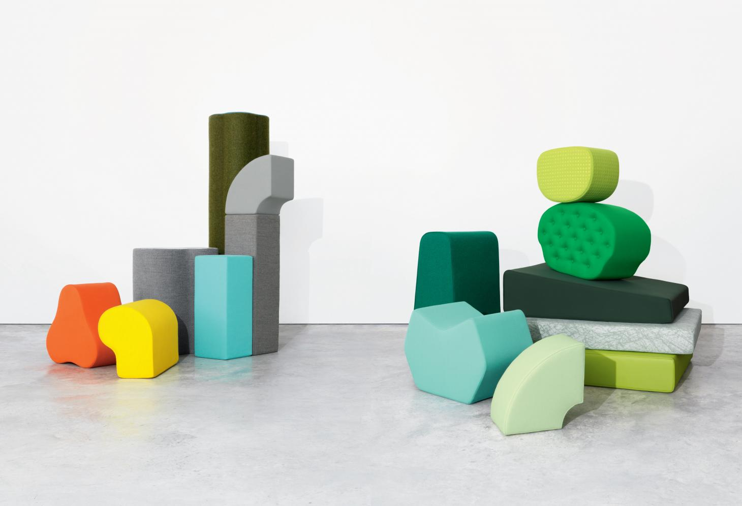 Kvadrat's textiles in bright colours are presented through a series of stacked upholstered abstract shapes