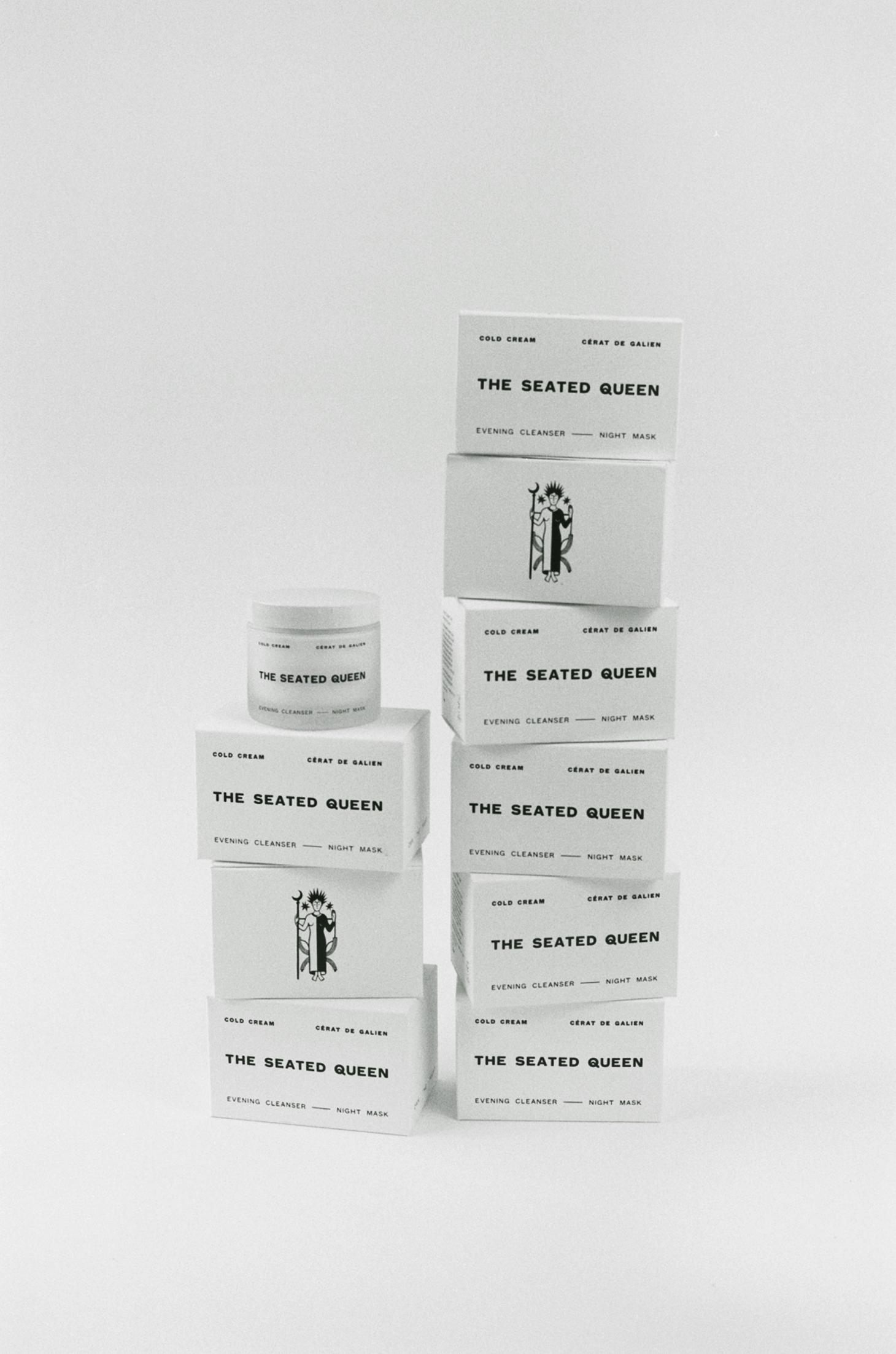 The Seated Queen cold cream in white packaging against grey background