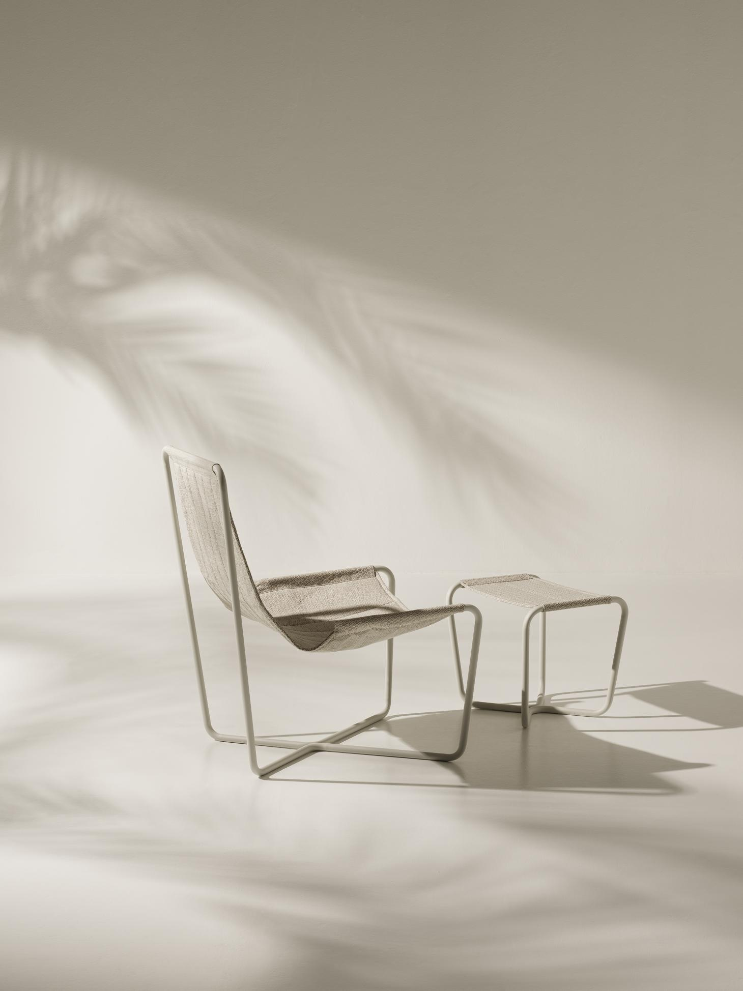 Side and back view of the garden chair by Studiopepe for Ethimo with footrest with the same design