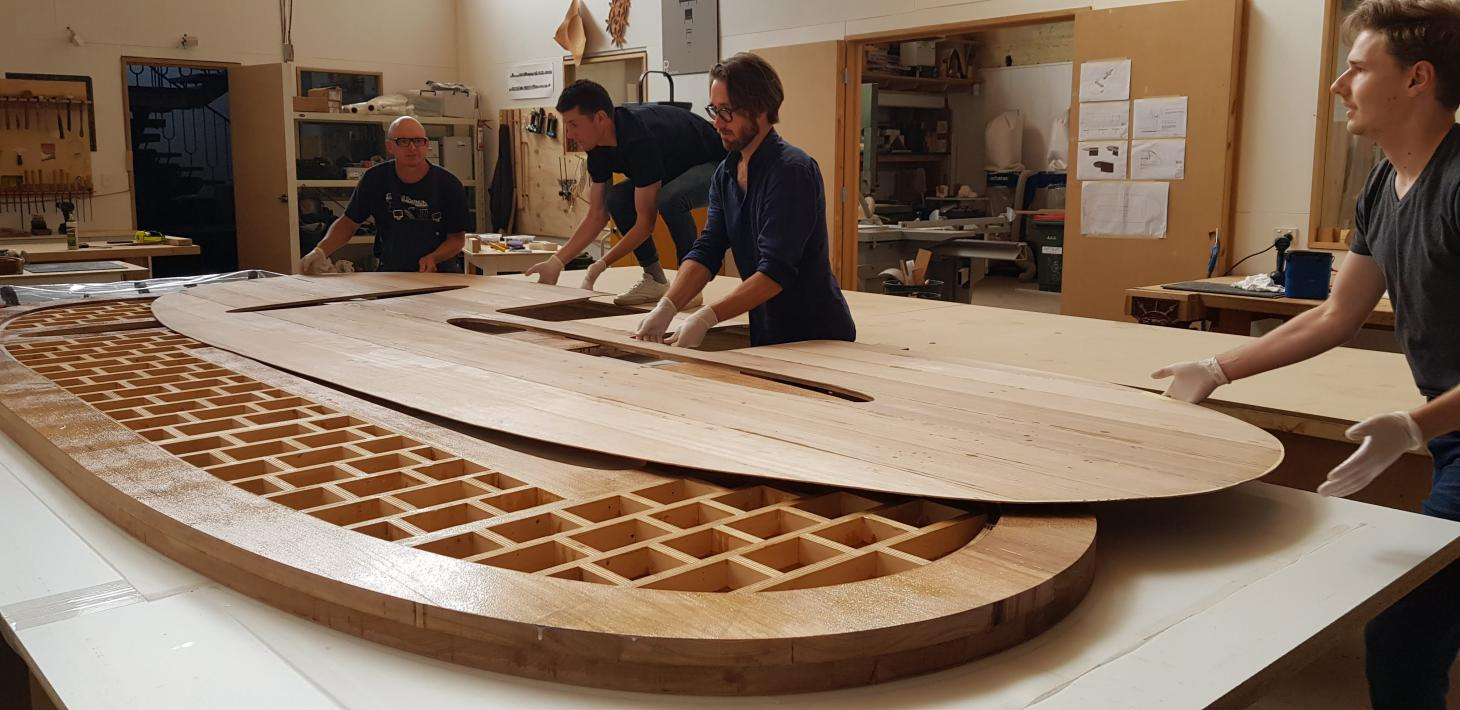Snøhetta's oval shaped Intersection Worktable made from Tasmanian Oak being constructed by the team