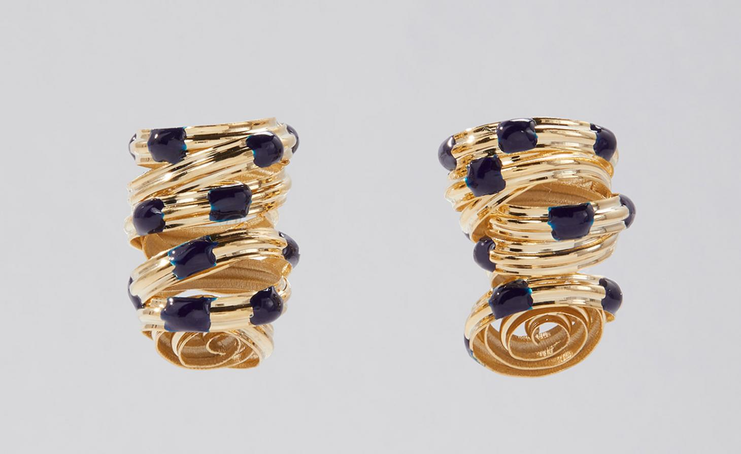 Gold-coated brass curly earrings with blue dots on