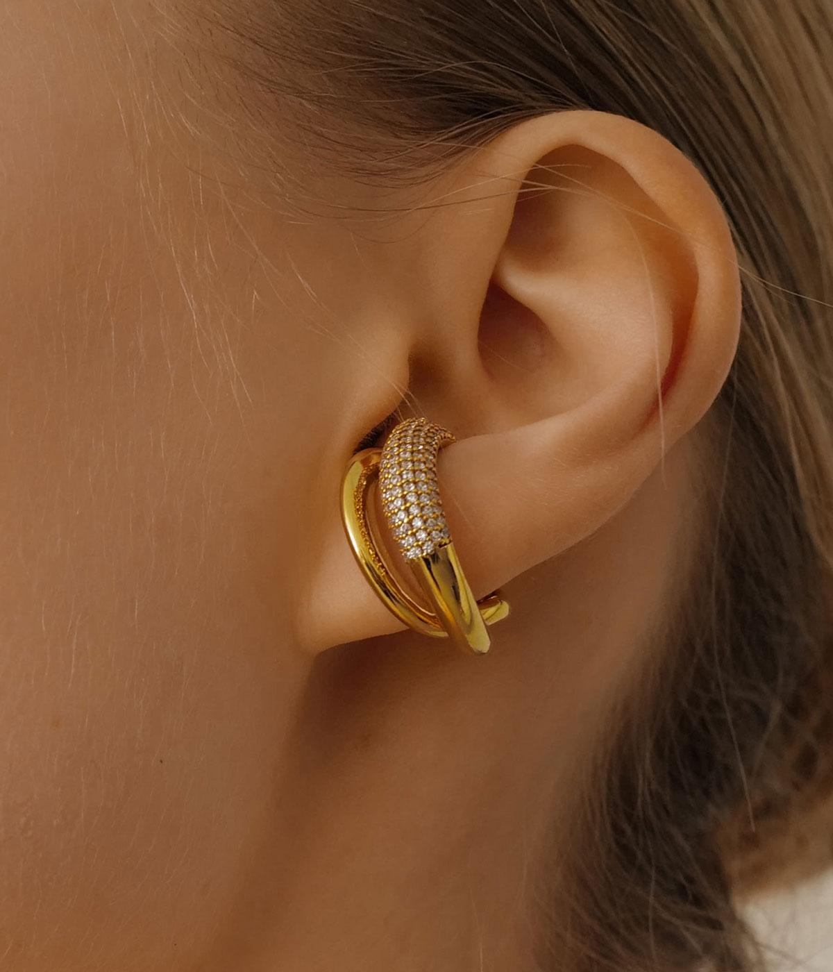 Womans ear wearing a gold and damond hoop