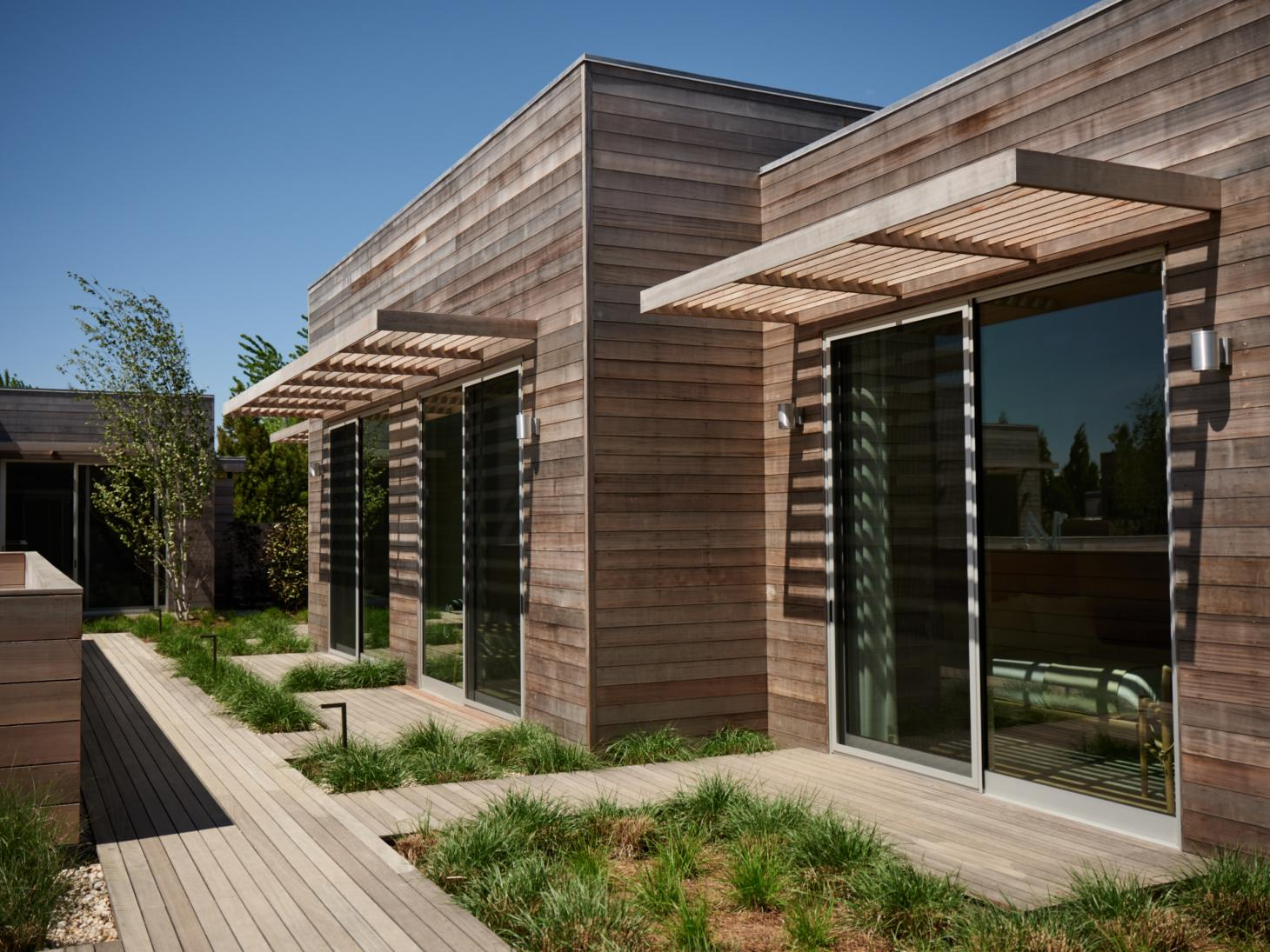 Wooden exterior of Shou Sugi Ban House in the Hamptons New York