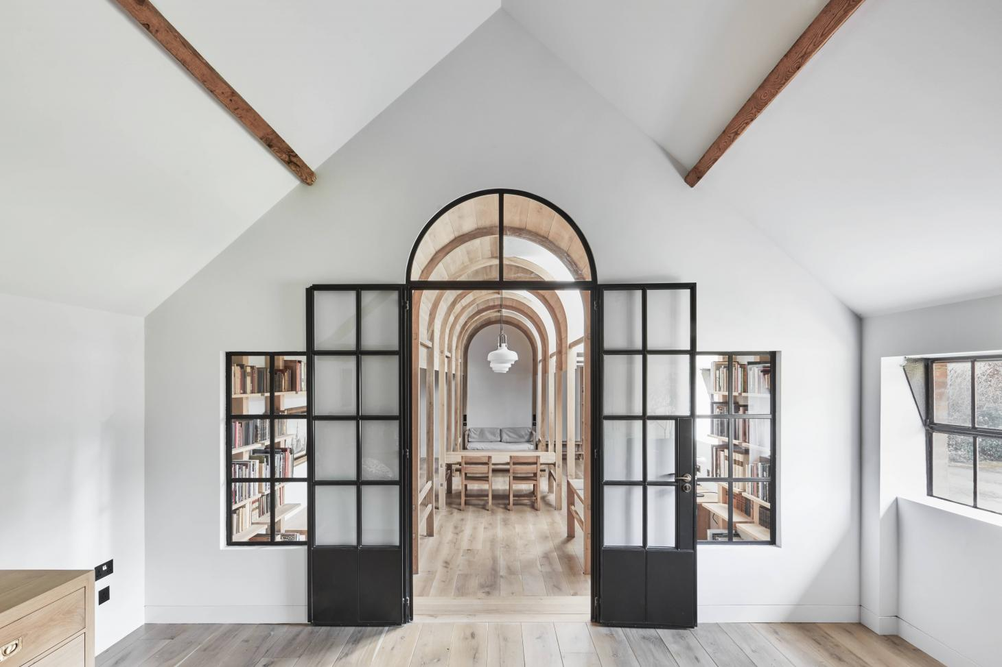 wood and brick in tactile composition define Dorset library in renovated outbuilding