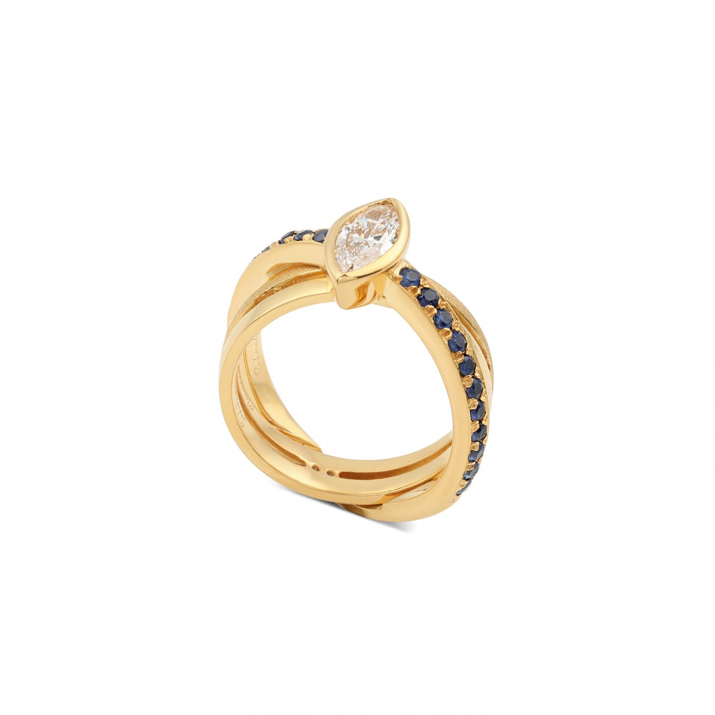gold engagement ring with a blue stone
