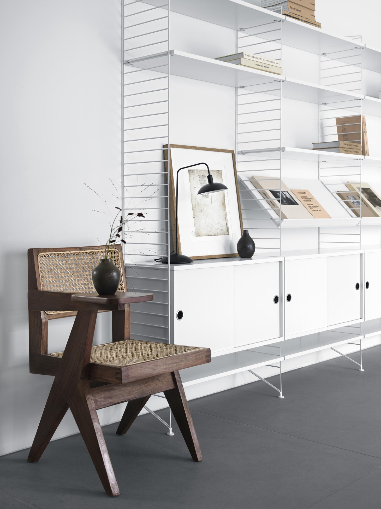 String shelving in white with modernist wooden chair