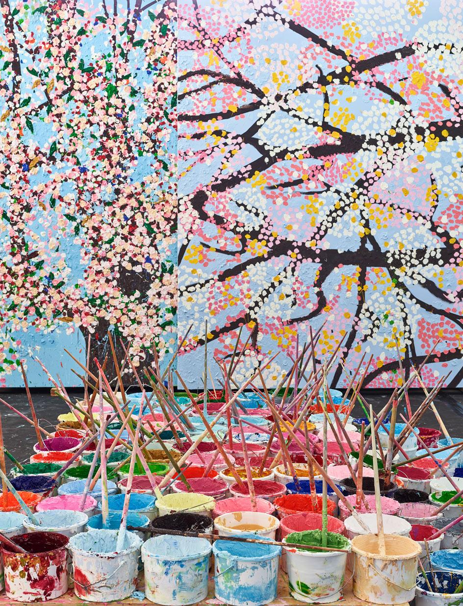 View of cherry blossoms paintings in Damien Hirst's studio