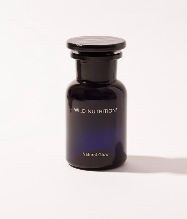 Wild Nutrition Natural Glow supplements for sun protection in blue glass bottle