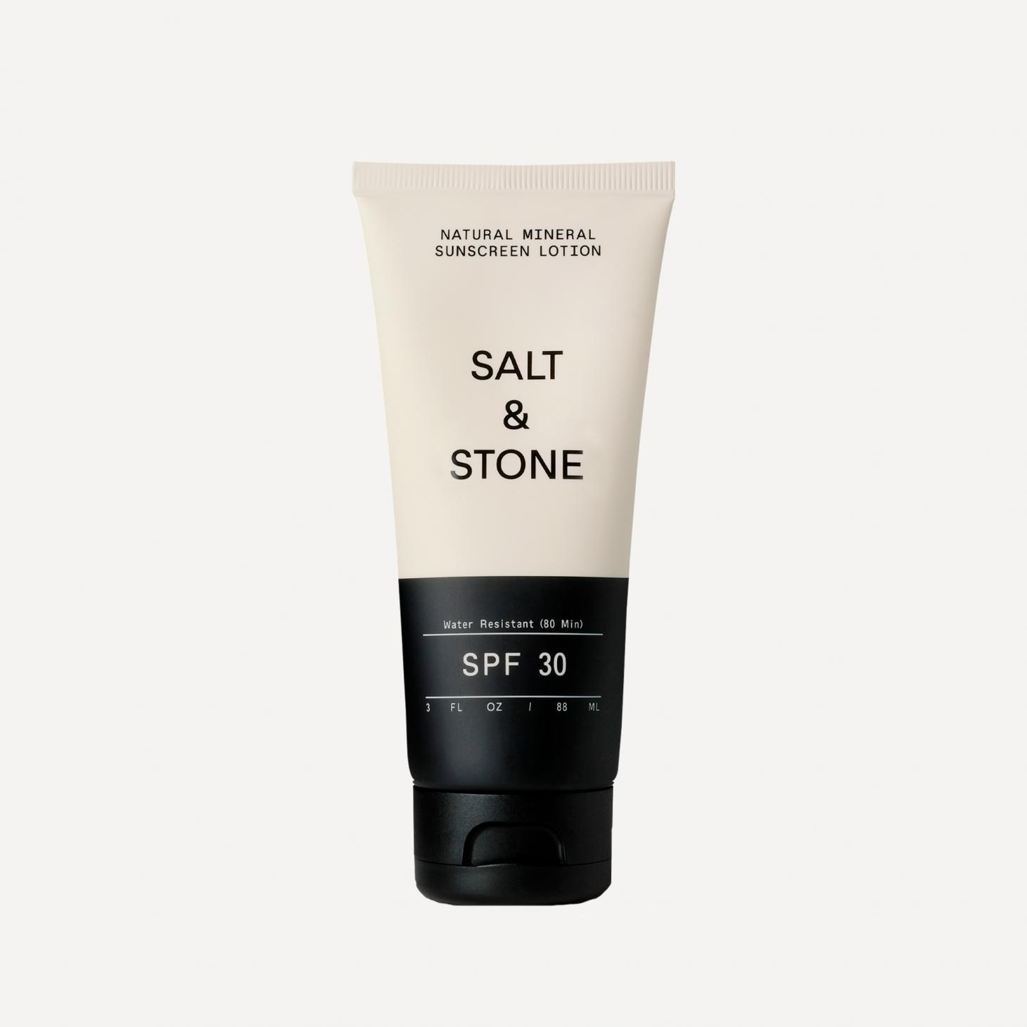 salt and stone organic sunscreen in black and white bottle