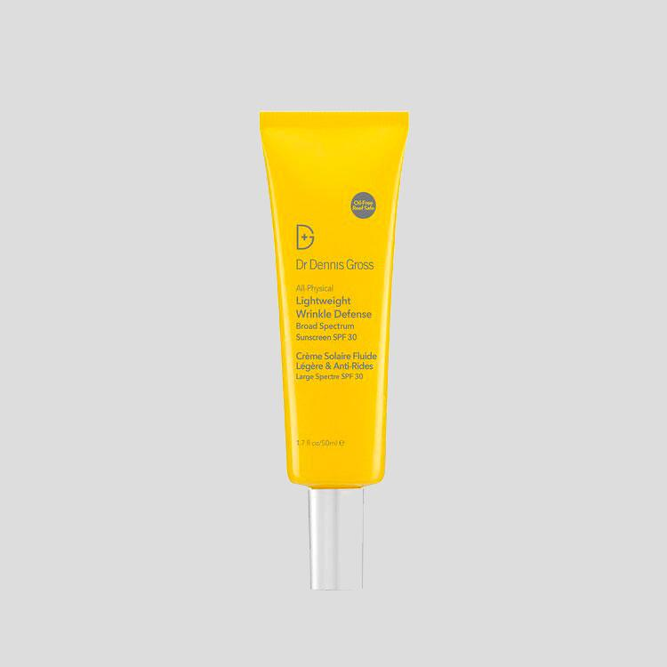Dr Dennis Gross All-Physical Lightweight Wrinkle Defense Sunscreen in yellow tube against grey background