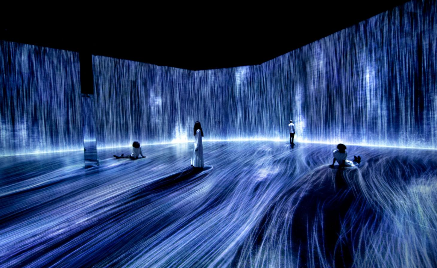 People in a hall surrounded by a water effect