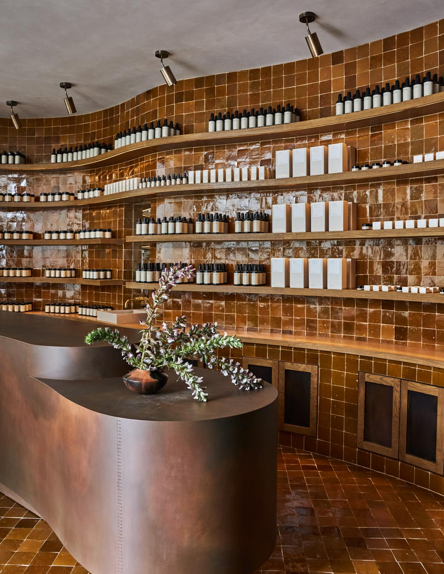 Suraya Spa in Los Angeles herb and natural remedy station with brown tiled while and steel table