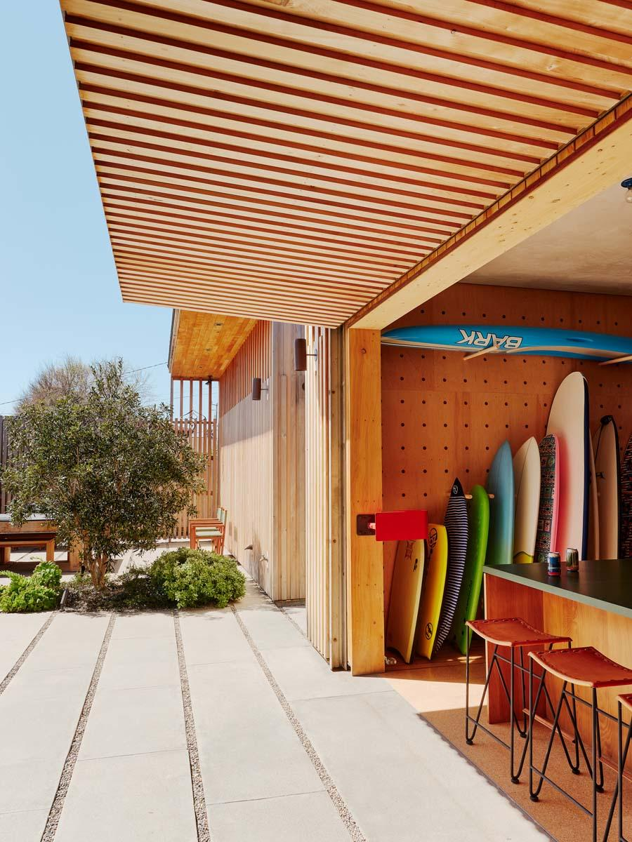 sifting boards peeking out from living space at the Surf House