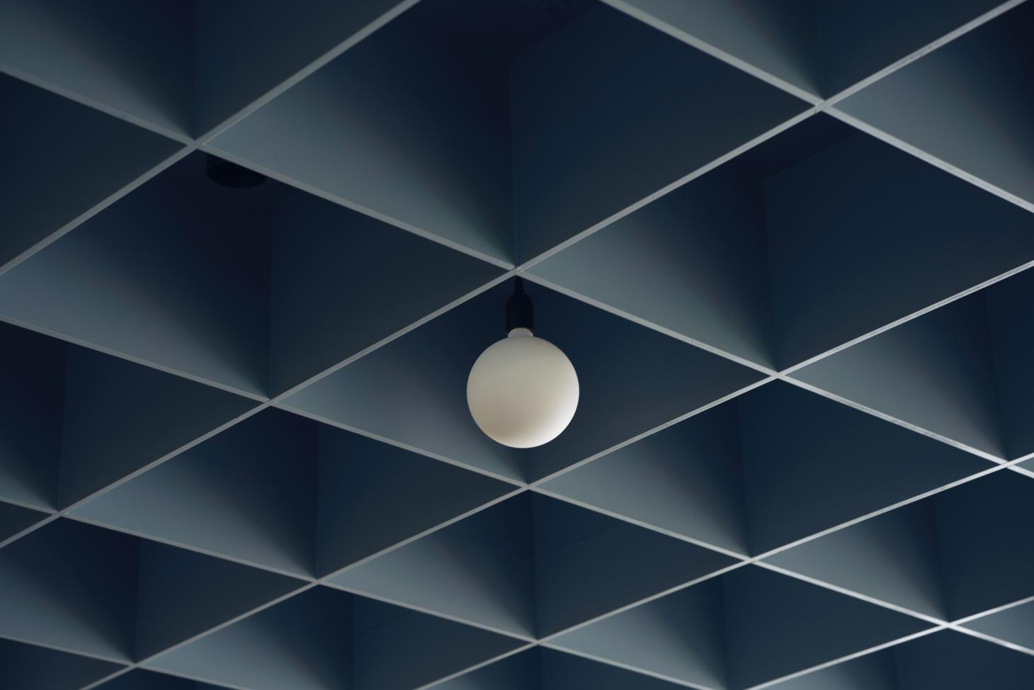 blue grid ceiling in converted London post office designed by Child Studio for Maido Sushi