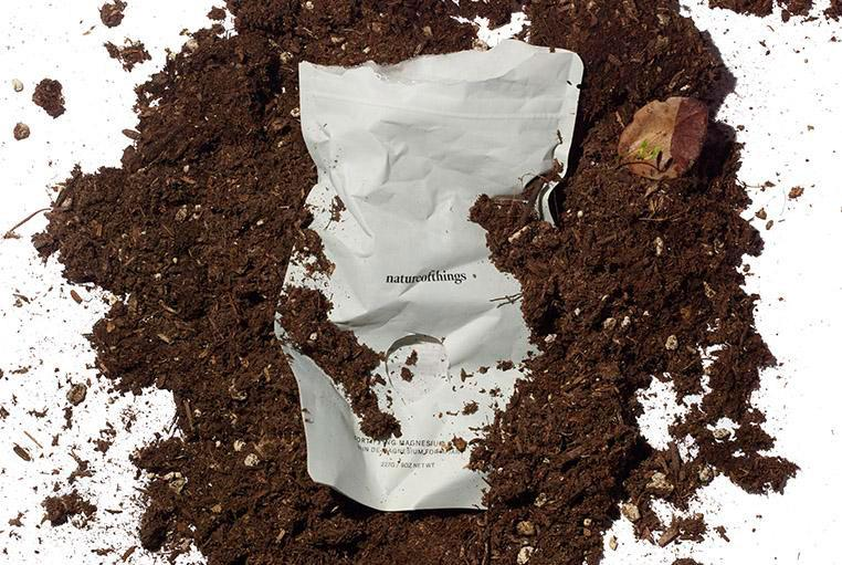 natureofthings bath soak compostable bag in dirt