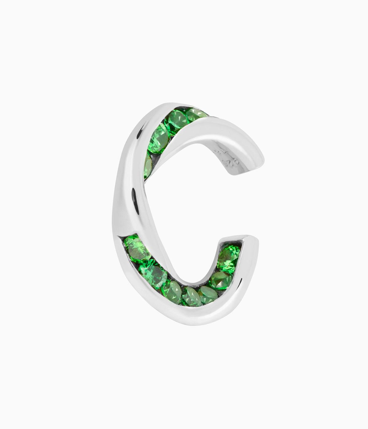 Silver cuff dotted with green topaz