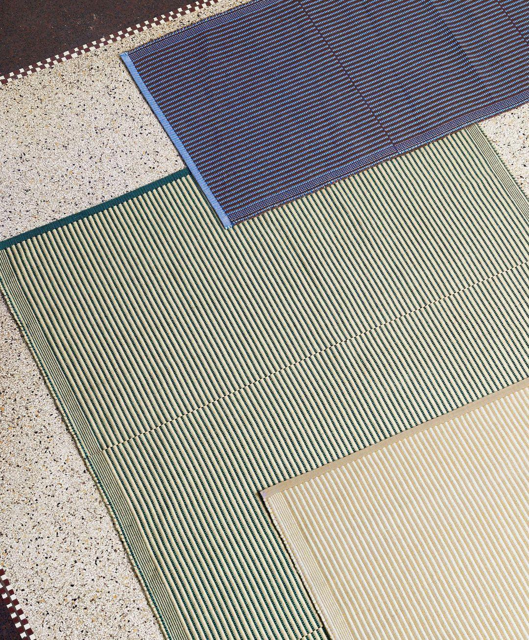 Striped rugs by Julie Richoz for Hay in green, beige and blue
