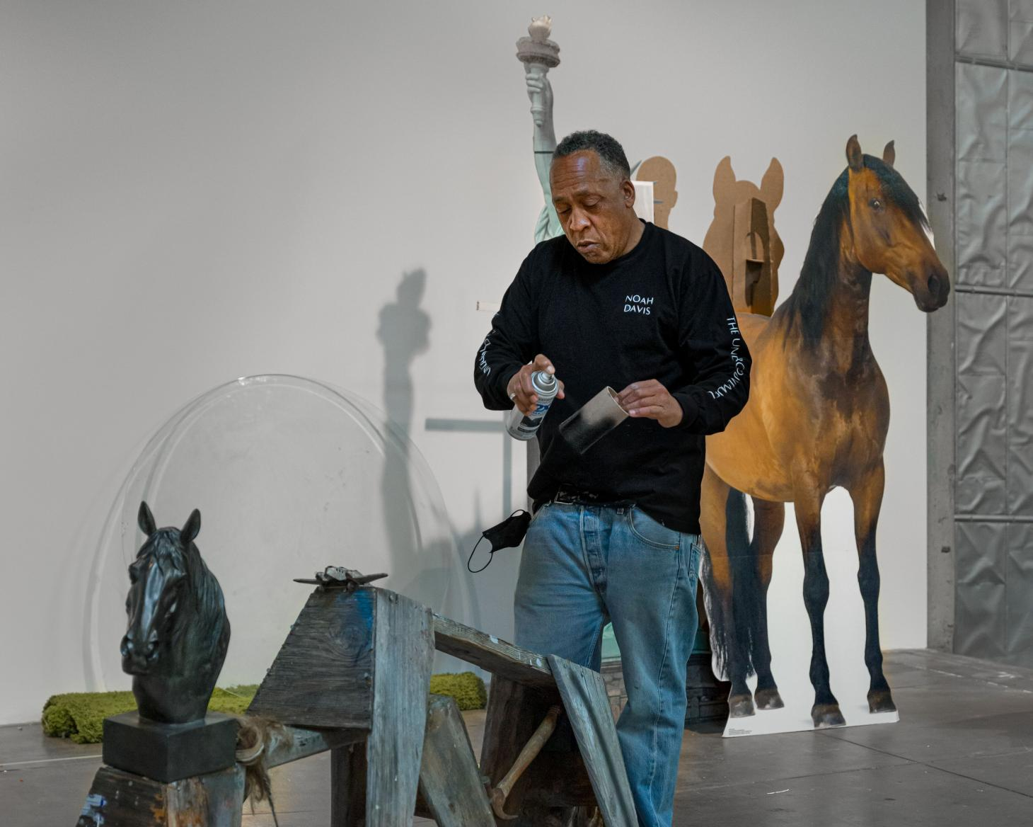 Image of artist Henry Taylor at work at Hauser & Wirth Somerset.