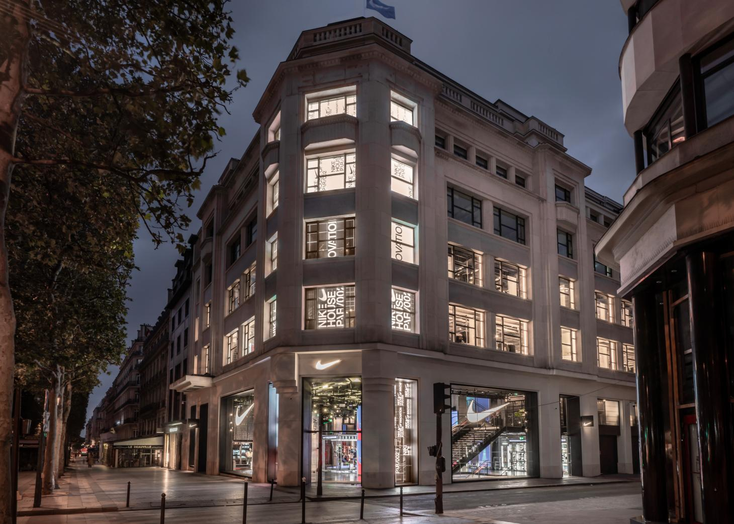 Nike's new Paris flagship external facade view from the street at evening time