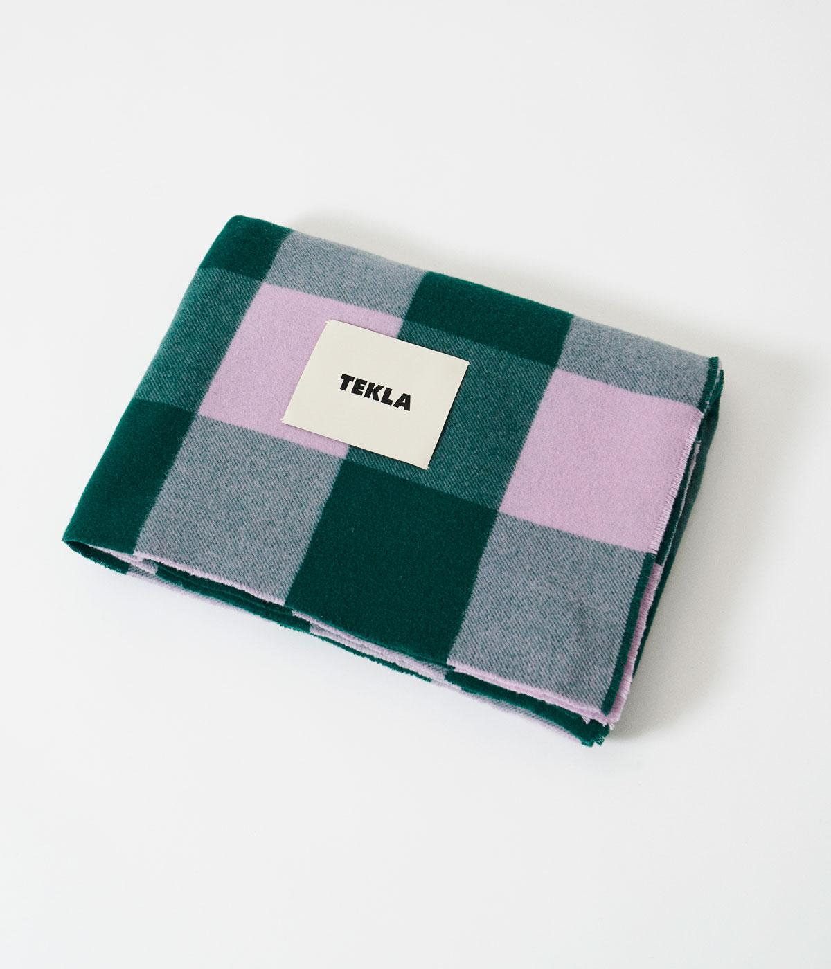 Tekla picnic blanket folded up in green and purple